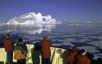 tourists and arctic iceberg
