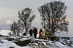 Sami people and tourists hail the sun after polar night