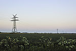high-voltage transmission line in agricultural landscape