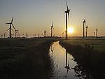 windmills at sunrise