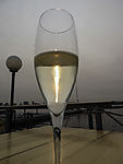 red sun behind glass Prosecco