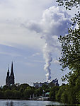 steam cloud from coal power plant over Elbphilharmonie