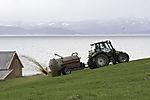 farmer prepairs meadow with liquid manure