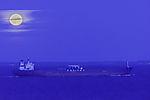 full Moon over freighter