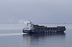 cargo ship with exhaust