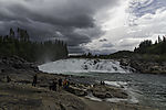 tourists at waterfall Laksforsen