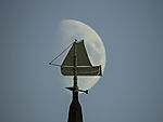 Moon behind steeple