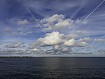 clouds and contrails over island Helgoland