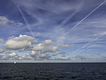 clouds and contrails over North Sea