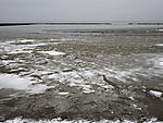 snow and ice in tidal sea