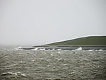stormy waters at dike