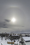 sun with halo over Tromso
