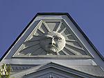 sun symbol on pediment