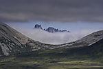 Trehörningen und Wolken auf Kvalöya