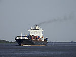 container ship with exhaust on river Elbe