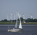 windpark and sailing boat at river Elbe