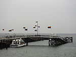 colourful flags on pier of island Helgoland