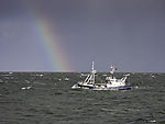 fishing boat with rainbow