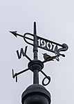 Spotted Woodpecker on weather vane, Dendrocopus sp.