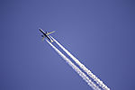 airplane with condensation trails