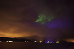 aurora borealis and light pollution on clouds