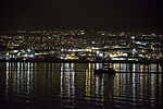 sailing boat befor island Tromso in night