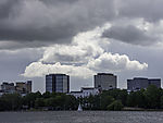 sailing boat under clouds on lake Alster