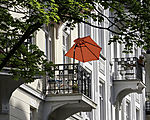 red parasol on balcony