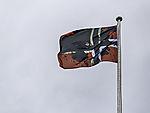 ölverschmutzte norwegische Flagge