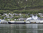ships exhaust over freighter in Tromso harbour