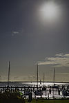 sun over boat harbour Vitte on island Hiddensee