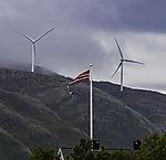 windmills on island Kvalöya with norwegian streamer