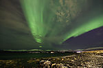 aurora over beach with stones