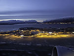 airplane starts from Tromso in polar night
