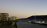 Gürtel der Venus über Bootshafen in Tromsö
