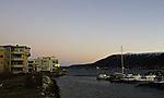 Belt of Venus over boat harbour in Tromso