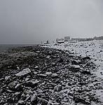 Schneefall am Strand