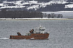 oil recovery boat in snowfall