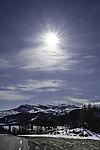 sun over windpark Kvitfjell on island Kvalöya