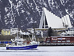 trawler before arctic cathedral in Tromso