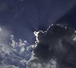 Sonne hinter Quellwolke