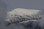 Neuschnee auf Tromsdalstinden bei Tromsö
